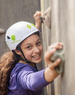 Girl on Rock Wall